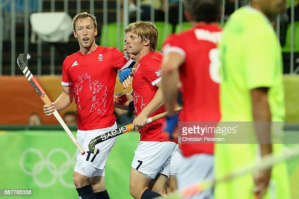 Barry Middleton of Great Britain is congratulated by Ashley Jackson after Middleton scored a goal against Brazil during the hockey game on Day 4 of...