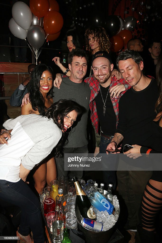 Barry Mullineaux (r), Alex Masnyk (2nd r), Jon Cantor (c), and guests celebrate Jon Cantor's birthday at Greenhouse on February 7, 2013 in New York City.