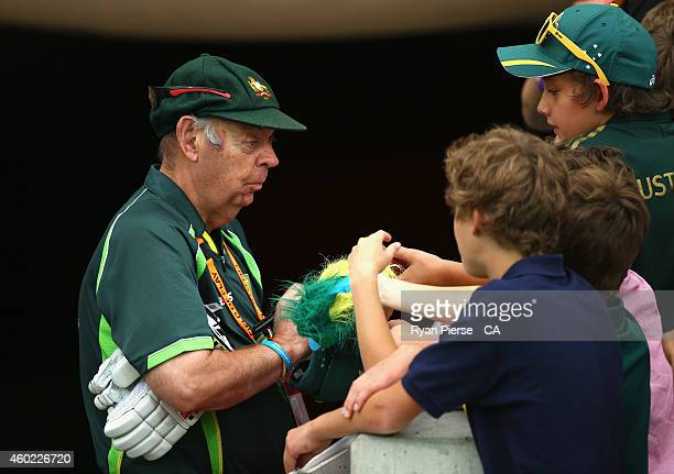 Barry 'Nugget' Rees signs autographs for fans during day two of the First Test match between Australia and India at Adelaide Oval on December 10 2014...