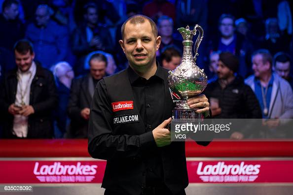 Barry S Hawkins of England celebrates with the trophy after winning the final match against Ryan Day of Wales on day seven of 2017 Ladbrokes World...