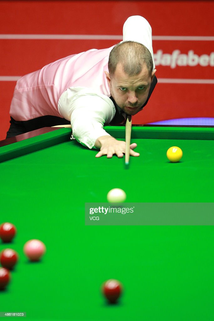 Barry S. Hawkins of England plays a shoot against David Gilbert of England during day four of the The Dafabet World Snooker Championship at Crucible Theatre on April 22, 2014 in Sheffield, England.