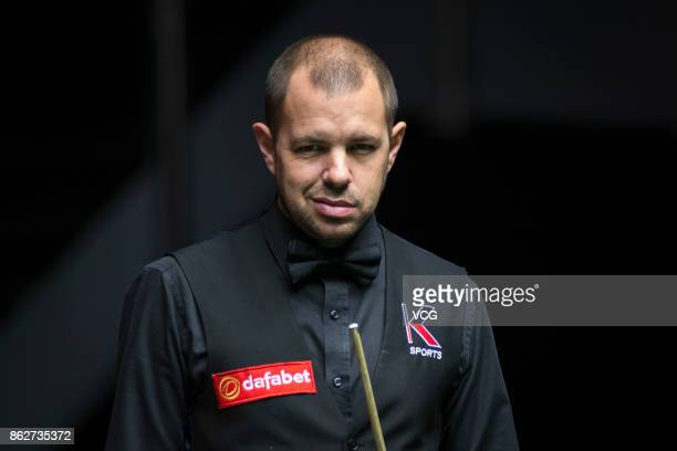Barry S Hawkins of England reacts during his second round match against Chen Zifan of China on day three of 2017 Dafabet English Open at Barnsley...