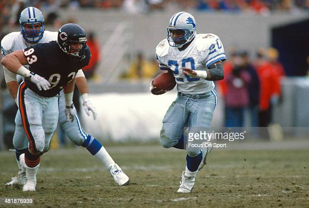 Barry Sanders of the Detroit Lions carries the ball against the Chicago Bears during an NFL football game December 10 1989 at Soldier Field in...