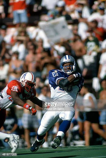 Barry Sanders of the NFC carries the ball against the AFC during the 1996 NFL Pro Bowl Game February 4 1996 at Aloha Stadium in Honolulu Hawaii The...