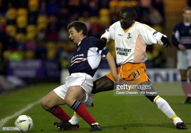 Barry Smith of Dundee holds off Livingston's Cherif Toure Maman during their Bank of Scotland Scottish Premier League match at Livingston's...