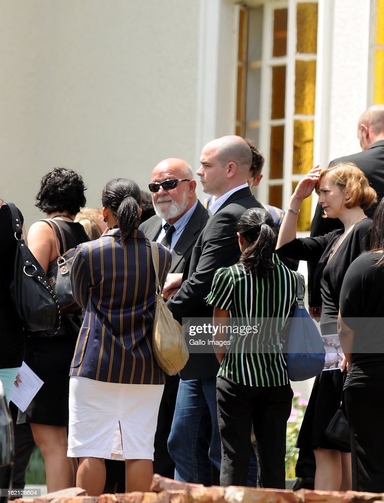 Barry Steenkamp, Reeva's father, is surrounded by family and friends as he arrives at Reeva's memorial on February 19, 2013 in Port Elizabeth, South Africa. Steenkamp was allegedly murdered by boyfriend, Oscar Pistorius on February 14, 2013. Pistorius, who has been charged with the murder, is appearing in court today for his bail hearing. Steenkamp's memorial is being held at The Victoria Park Crematorium.