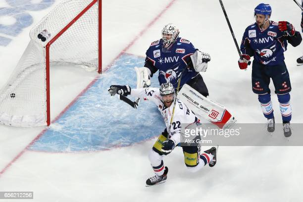 Barry Tallackson of Berlin celebrates his team's first goal during the DEL Playoffs quarter finals Game 7 between Adler Mannheim and Eisbareren...