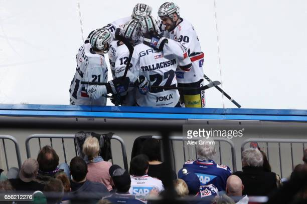 Barry Tallackson of Berlin celebrates his team's first goal with team mates during the DEL Playoffs quarter finals Game 7 between Adler Mannheim and...