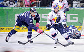 Barry Tallackson of the Eisbaeren Berlin and Keith Aucoin of EHC Red Bull Muenchen fight for the puck during the game between the Eisbaeren Berlin...