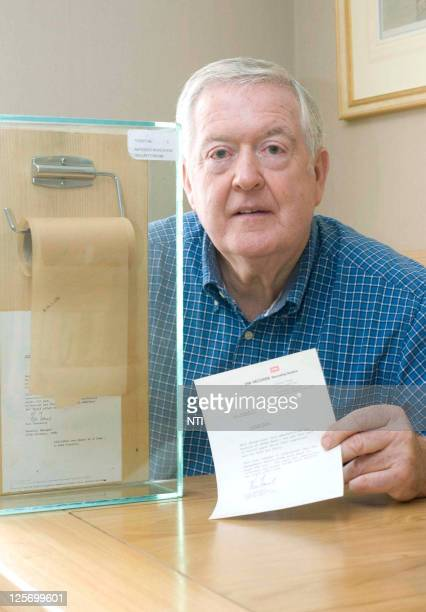 Barry Thomas poses with the toilet roll he bought from an auction for £8500 GBP which was rejected by the Beatles when they were recording at the...