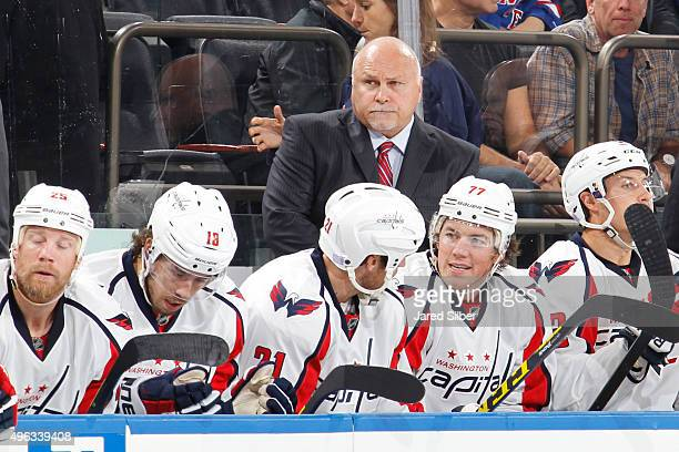 Barry Trotz head coach of the Washington Capitals looks on from the bench during the game against the New York Rangers at Madison Square Garden on...