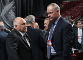 Barry Trotz head coach of the Washington Capitals talks with Brian MacLellan general manager of the Washington Capitals during Day Two of the 2014...