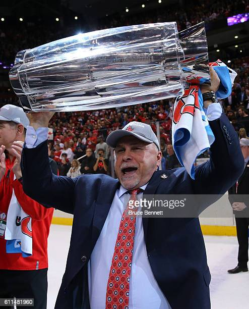 Barry Trotz of Team Canada celebrates with the trophy after his teams World Cup of Hockey Championship over Team Europe during Game Two of the World...