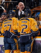 Barry Trotz of the Nashville Predators coaches during a timeout against the Colorado Avalanche at Bridgestone Arena on January 18 2014 in Nashville...