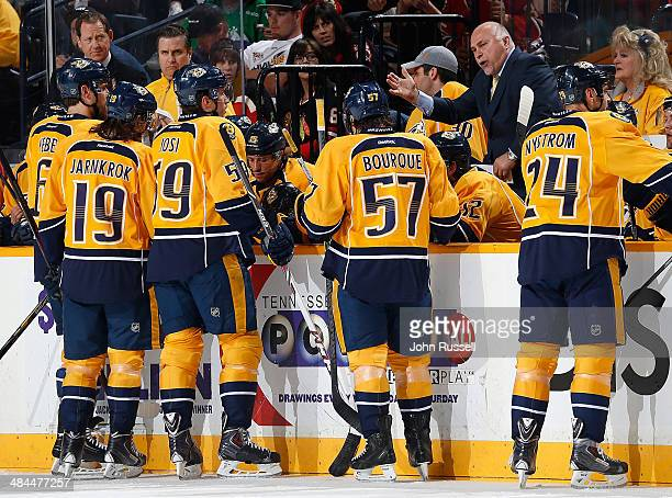 Barry Trotz of the Nashville Predators takes a timeout against the Chicago Blackhawks during an NHL game at Bridgestone Arena on April 12 2014 in...