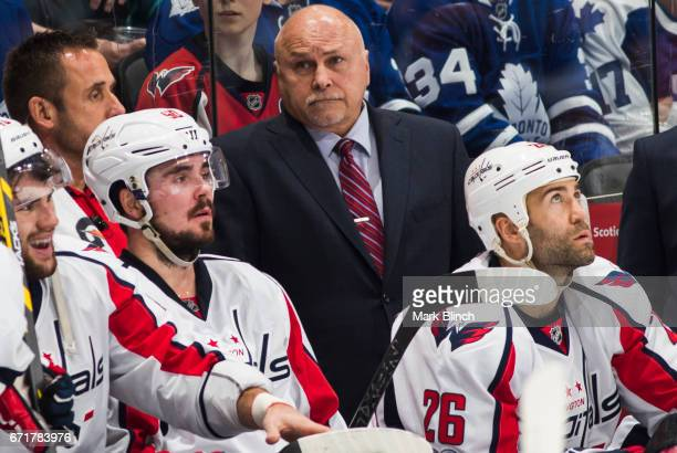 Barry Trotz of the Washington Capitals looks on as his team plays the Toronto Maple Leafs during the second period in Game Four of the Eastern...