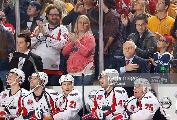 Barry Trotz of the Washington Capitals pats his heart during a tribute to him during a game against the Nashville Predators during an NHL game at...