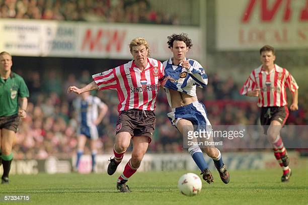Barry Venison of Southampton challenges Ryan Giggs of Manchester United for the loose ball during the FA Carling Premiership match between...