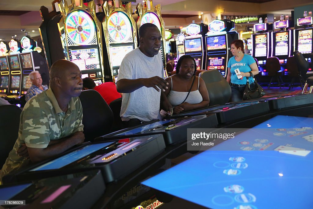 Barry wright (L), Freddy Boatwright (C) and Monar Smith enjoy playing a digital Blackjack machine in the casino that will hold its grand opening on Friday located in the Hialeah Park Race Track which first opened in 1925 on August 28, 2013 in Hialeah, Florida. The new casino is located in the same complex as the race track which in its heyday was known as the 'the worlds most beautiful race course.'