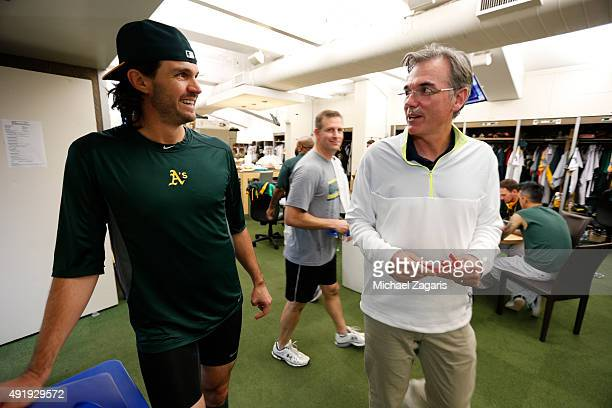 Barry Zito and General Manager Billy Beane of the Oakland Athletics talk in the clubhouse prior to the game against the Texas Rangers at Oco Coliseum...