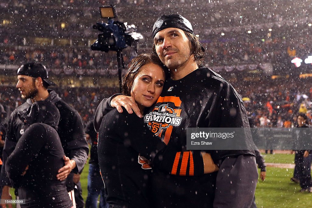 Barry Zito #75 of the San Francisco Giants and wife Amber Zito celebrate after the Giants 9-0 victory against the St. Louis Cardinals in Game Seven of the National League Championship Series at AT&T Park on October 22, 2012 in San Francisco, California.