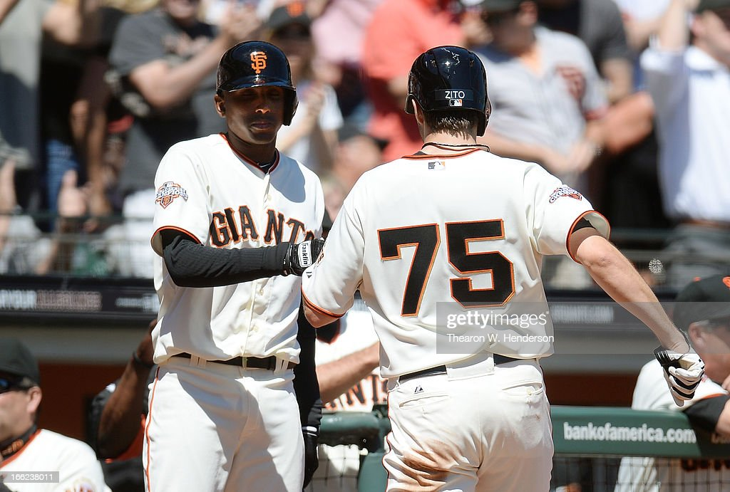 <a gi-track='captionPersonalityLinkClicked' href=/galleries/search?phrase=Barry+Zito&family=editorial&specificpeople=202943 ng-click='$event.stopPropagation()'>Barry Zito</a> #75 of the San Francisco Giants is congratulated by Joaquin Arias #13 after Zito scored on an RBI double by Buster Posey #28 against the Colorado Rockies in the bottom of the second inning at AT&T Park on April 10, 2013 in San Francisco, California.