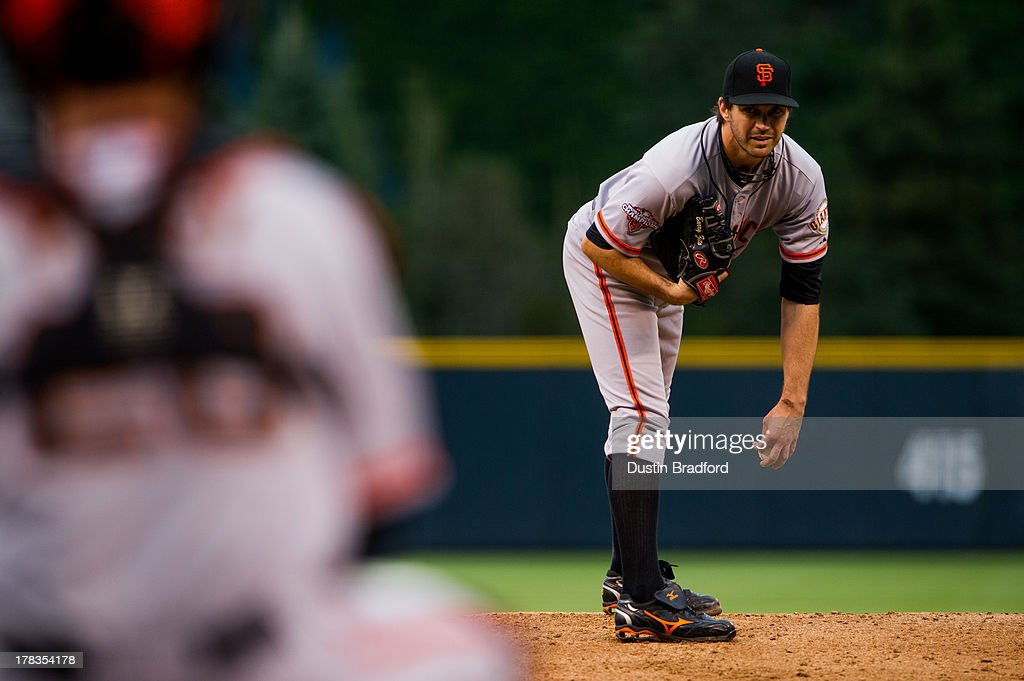 Barry Zito #75 of the San Francisco Giants looks for a sign against the Colorado Rockies in the first inning of a game against the Colorado Rockies at Coors Field on August 26, 2013 in Denver, Colorado.