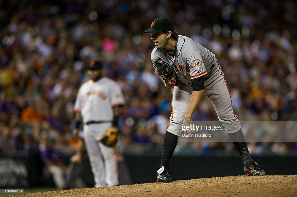 Barry Zito #75 of the San Francisco Giants looks for a sign as he pitches against the Colorado Rockies at Coors Field on August 26, 2013 in Denver, Colorado. The Rockies beat the Giants 6-1.