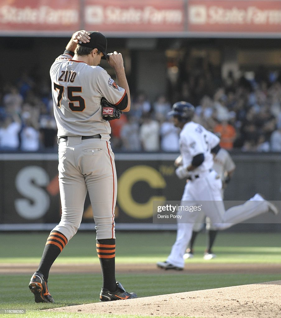 <a gi-track='captionPersonalityLinkClicked' href=/galleries/search?phrase=Barry+Zito&family=editorial&specificpeople=202943 ng-click='$event.stopPropagation()'>Barry Zito</a> #75 of the San Francisco Giants steps off the mound as Jesus Guzman #15 of the San Diego Padres rounds the bases after hitting a three-run homer during the first inning of a baseball game at Petco Park on July 16, 2011 in San Diego, California.