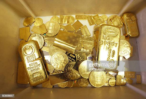 Bars coins and other objects made of gold wait to be remelted as they didn't pass the standards at Austrian gold bullion factory Oegussa on October 8...
