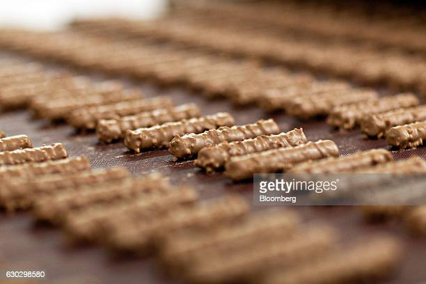 Bars of Cailler branded 'branche' chocolate travel along the production line at the Nestle SA production facility in Broc Switzerland on Monday Dec...