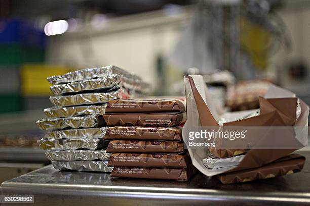 Bars of Cailler branded 'Les Recettes de l'Atelier' luxury chocolate await a quality control check at the Nestle SA production facility in Broc...