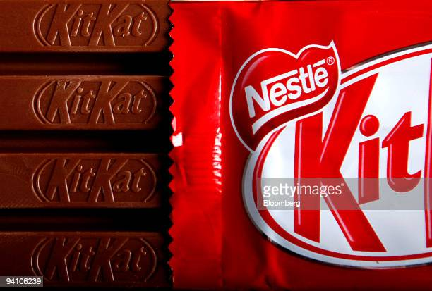 Bars of original KitKat chocolate produced by Nestle SA and without the 'Fairtrade' logo sit arranged for a photograph in London UK on Monday Dec7...