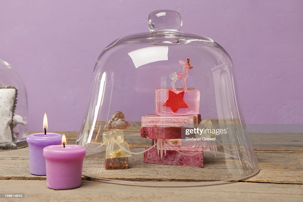 Bars of soap and candles with bell jar : Stock Photo