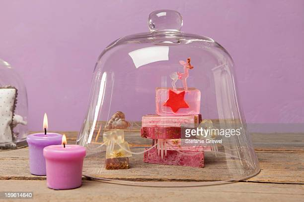 Bars of soap and candles with bell jar