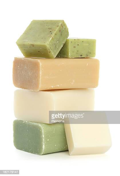 Bars of soap stacked on a white background