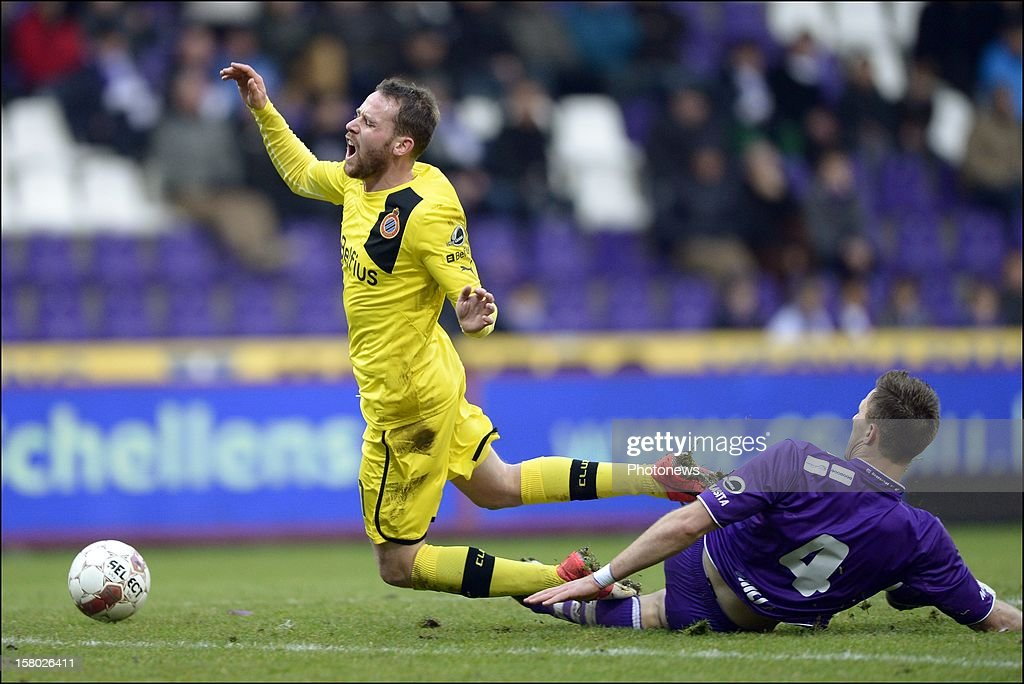 Bart Buysse of Club Brugge KV is tackled by Frederic Brillant of Beerschot AC during the Jupiler League match between Beerschot AC and Club Brugge on December 09, 2012 in the Kiel Stadium in Antwerpen, Belgium.