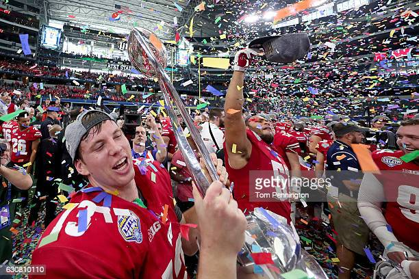 Bart Houston of the Wisconsin Badgers celebrates with the trophy after the Wisconsin Badgers beat the Western Michigan Broncos 2416 in the 81st...