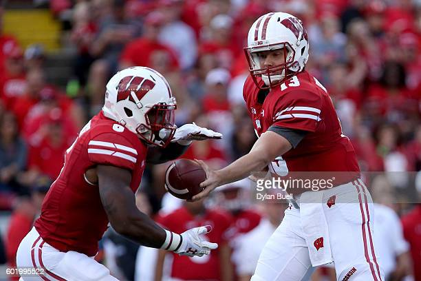 Bart Houston of the Wisconsin Badgers hands the ball off to Corey Clement of the Wisconsin Badgers in the first quarter at Camp Randall Stadium on...