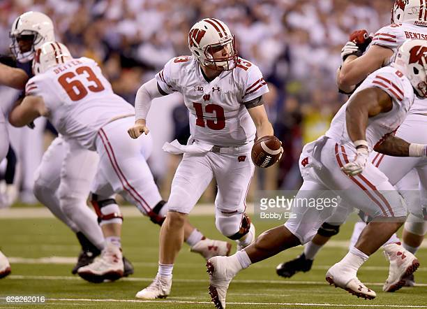 Bart Houston of the Wisconsin Badgers runs with the ball during the first quarter of the Big Ten Championship game against the Penn State Nittany...