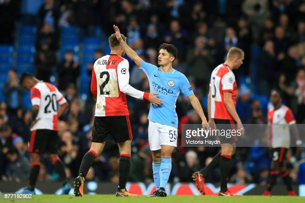 Bart Nieuwkoop of Feyenoord and Brahim Diaz of Manchester City thank each other after the UEFA Champions League group F match between Manchester City...