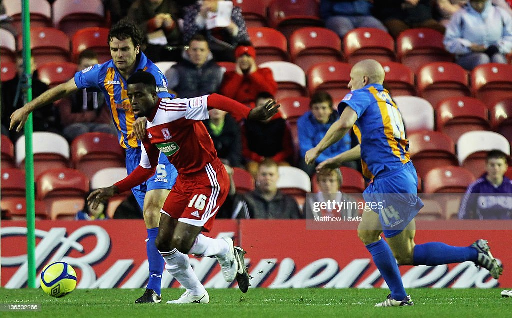 Bart Ogbeche of Middlesbrough holds off Ian Sharps of Shrewsbury during the FA Cup Third Round match between Middlesbrough and Shrewsbury Town at Riverside Stadium on January 7, 2012 in Middlesbrough, England.