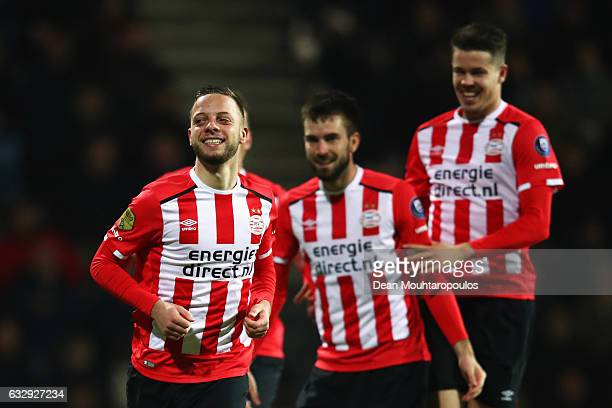 Bart Ramselaar of PSV celebrates scoring his teams first goal of the game with team mates during the Dutch Eredivisie match between Heracles Almelo...