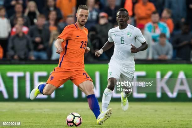 Bart Ramselaar of The Netherlands Jean Michel Seri of Ivory Coastduring the friendly match between The Netherlands and Ivory Coast at the Kuip on...
