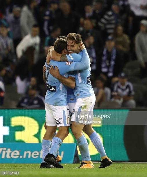 Bart Schenkeveld Nick Fitzgerald and Manny Muscat of Melbourne City celebrate after the City defeated the Victory during the round two ALeague match...