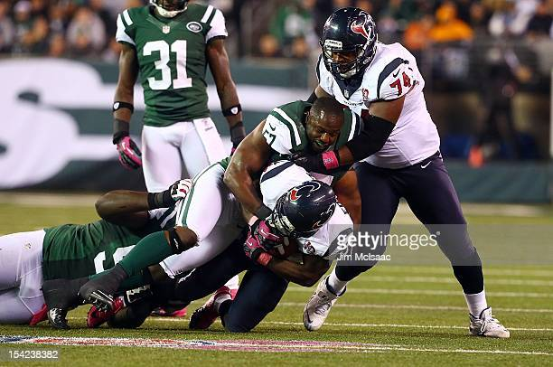 Bart Scott of the New York Jets in action against Justin Forsett and Wade Smith of the Houston Texans at MetLife Stadium on October 8 2012 in East...