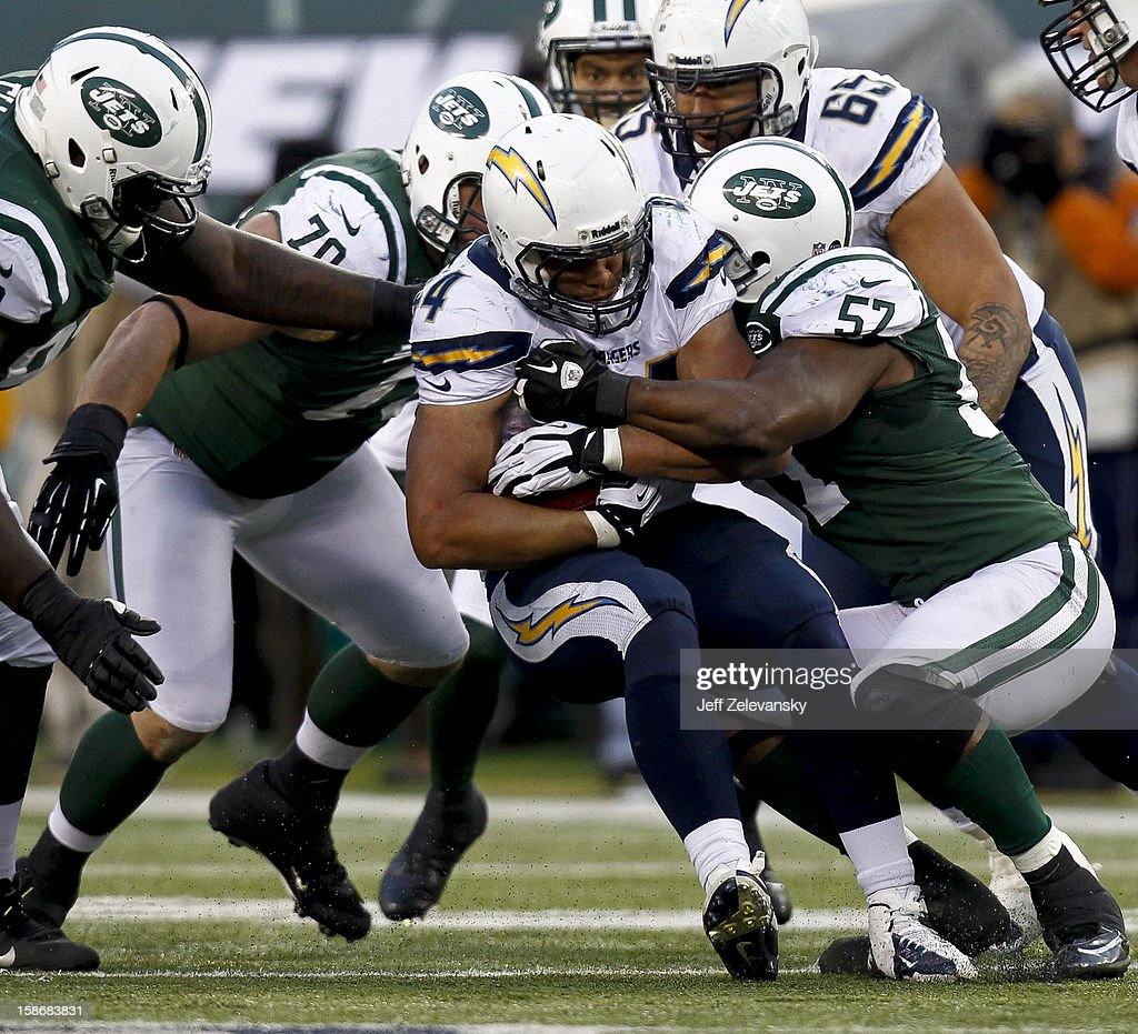<a gi-track='captionPersonalityLinkClicked' href=/galleries/search?phrase=Bart+Scott&family=editorial&specificpeople=582805 ng-click='$event.stopPropagation()'>Bart Scott</a> #57 of the New York Jets takes down <a gi-track='captionPersonalityLinkClicked' href=/galleries/search?phrase=Jackie+Battle&family=editorial&specificpeople=2852926 ng-click='$event.stopPropagation()'>Jackie Battle</a> #44 of the San Diego Chargers at MetLife Stadium on December 23, 2012 in East Rutherford, New Jersey.