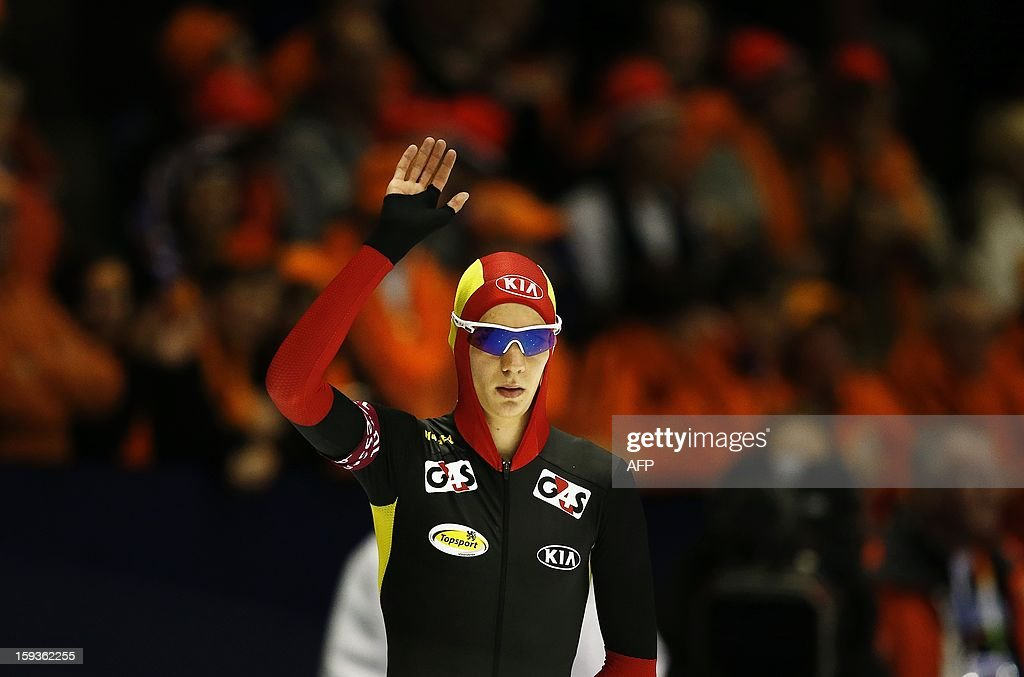 Bart Swings from Belgium waves before compete in the men's 500 meter race at the European Speed Skating Championships in Heerenveen, Netherlands, on January 11, 2013. The championships started today and be held until January 13. AFP PHOTO / ANP / BAS CZERWINSKI - netherlands out -