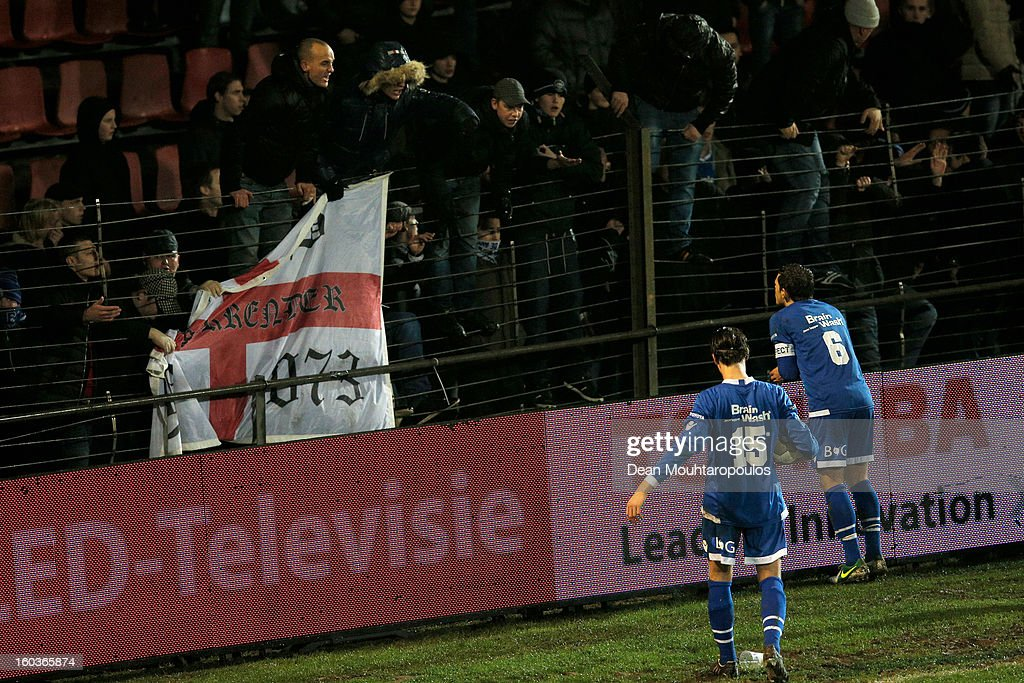 Bart van Brakel (#6) and Marco Rutten (#15) of Den Bosch ask the home fans to calm down during the KNVB Dutch Cup match between FC Den Bosch and AZ Alkmaar at BrainWash Stadion De Vliert on January 29, 2013 in Bosch, Netherlands.