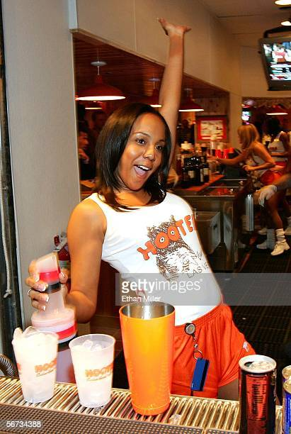 Bartender Adrienne Turner greets a fellow employee while making drinks at the Hooters Restaurant during the grand opening of the Hooters Casino Hotel...